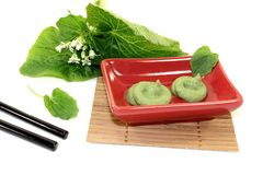 Wasabi with Chopsticks, leaves and blossoms Royalty Free Stock Images