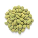 Wasabi coated peanuts. Pile of wasabi coated peanuts  on white background shot from above Royalty Free Stock Photos