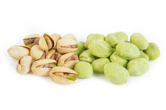 Wasabi coated pistachios on white Royalty Free Stock Photos