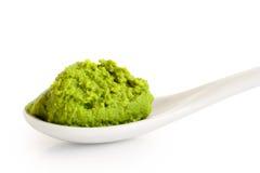 Wasabi paste on ceramic spoon on white. stock images