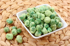 Wasabi peas. On white plate Royalty Free Stock Photography