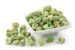 Wasabi peas. On white plate isolated on white background Stock Images