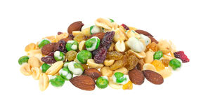 Wasabi peas almonds and dried fruit. A small portion of wasabi peas, golden raisins, almonds and dried cranberries on a white background stock image