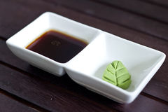 Wasabi on a plate and sauce Royalty Free Stock Photo