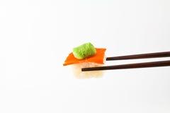 Wasabi on sushi. With chopsticks Royalty Free Stock Photos