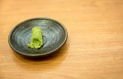 Wasabi, traditional japan herb in black plate on wood table. Herbs for japan sushi and sashimi cuisine. Ingradient japanese gourmet and medical food. Image for Royalty Free Stock Image