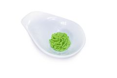 Wasabi in a white bowl. Isolated on white background Royalty Free Stock Image