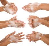 Waschen ihrer Hände Stockfotografie