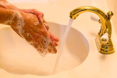 Waschende Hände Stockbild
