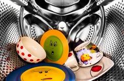 Waschende Teller Stockfoto