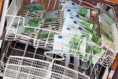 Waschendes Geld Stockfoto