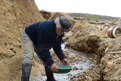 Waschendes Gold des Bergmannes in Tierra del Fuego Stockbilder