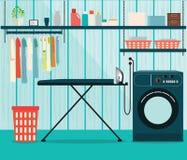 Waschküche mit Waschmaschine und Bügelbrett Stockfotos