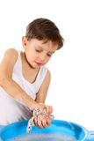 Wash. The little boy helps mother, erasing clothes Royalty Free Stock Images