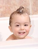 Wash. Face of baby with shampoo Stock Image