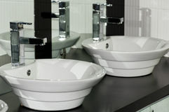 Wash Basin. A Double Wash Basin with Mirror Reflection royalty free stock photo
