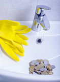 Wash basin and running water from the tap in chrome bathroom Royalty Free Stock Photo
