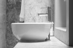 Wash basin. White wash basin on cement countertop Royalty Free Stock Photo