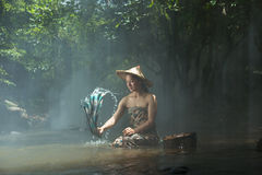 Wash laos women. Being of young people in the district near the mountain SangKhom of Nong Khai,Thailand Stock Photos