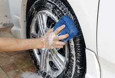 Wash a car. Man hand hold Sponge Car Wash,wash a  car by self at home Stock Photo
