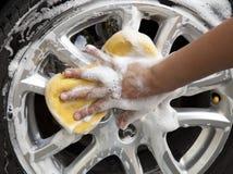 Wash. Car wash with yellow sponge Royalty Free Stock Photo