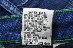 Wash care instructions on jeans Stock Image