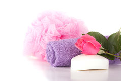 Wash cloth, shower puff, soap and pink rose Royalty Free Stock Photography