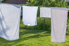 Wash clothes drying in the yard Royalty Free Stock Images