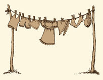 Wash clothing on clothesline. Vector drawing Stock Photos