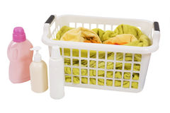 Wash colored laundry (isolated). Wash colored laundry. Detergents and towels in white plastic basket, basket with colorful laundry to wash (handwash Royalty Free Stock Photos
