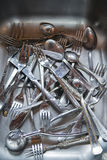 Wash the cutlery after the meal Royalty Free Stock Photos