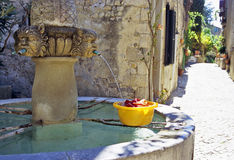 Wash Day. Laundry being washed in a fountain in a rural village in Provence royalty free stock image