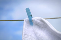 Wash day. Fluffy towel hanging with clothes pin on the line royalty free stock photos