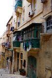 Wash Day, Valletta, Malta. Newly washed laundry is hung out to dry from quaint balconies in the capital city of Valletta on the Mediterranean island nation of Stock Photography