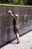 Woman in front of Vietnam Veterans Memorial in Washington D.C. Royalty Free Stock Photography