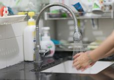 Wash hand by water in sink stock image