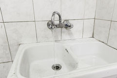 Wash hands unsanitary. Basin hands dirty public restroom, construction Royalty Free Stock Photo
