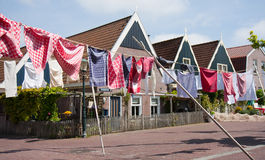 Wash hanging over the street in fishing village Stock Photo