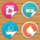 Wash icons. Machine washable at thirty degrees. Round stickers or website banners. Hand wash icon. Machine washable at 30 degrees symbols. Laundry washhouse and Royalty Free Stock Image