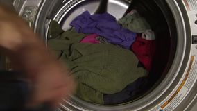 Wash machine with dirty clothes stock video