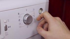 Wash mashine switching on.  stock footage