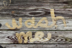 Wash me concept pressure washed into weathered wood Royalty Free Stock Photos