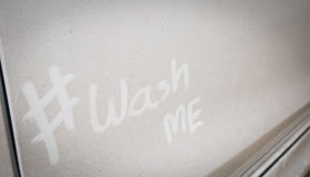 Wash me  on the dirty car Stock Photography