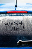 Wash Me Words on a Dirty Car Window. Wash Me Words on a Dirty Rear Car Window Royalty Free Stock Photography
