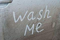 Wash me written on a dirty car Stock Photo