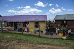 Wash outside a home in a South African township. Colorful wash hanging outside a house in a South African township in Knysna, in the South of South Africa stock photo