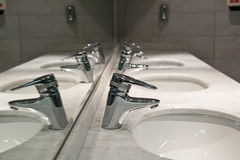 Wash sinks and taps Stock Photography