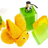 Wash skin colored soap dispenser and towels. Wash skin with colored soap dispenser and towels Royalty Free Stock Image