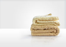 Wash towels on a white table, symbolizes the Laundry Royalty Free Stock Photos