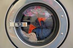 Wash tub spin. Photo of wash tub machine full of clothes on washing day stock image